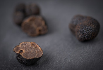 Black truffle mushrooms over rustic gray table