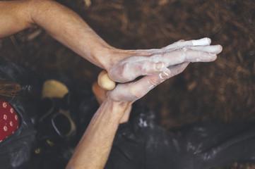 Close up of woman climber hands warming her feet