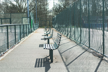 Park benches in a row sunny day