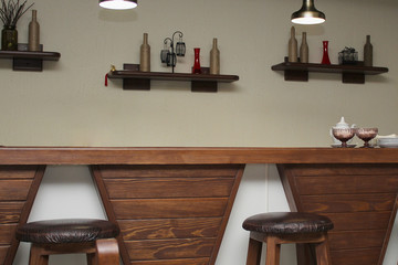 cafe interior design with bar and wooden chairs. the decor on the wall