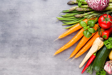 Flat lay of various colorful raw vegetables.