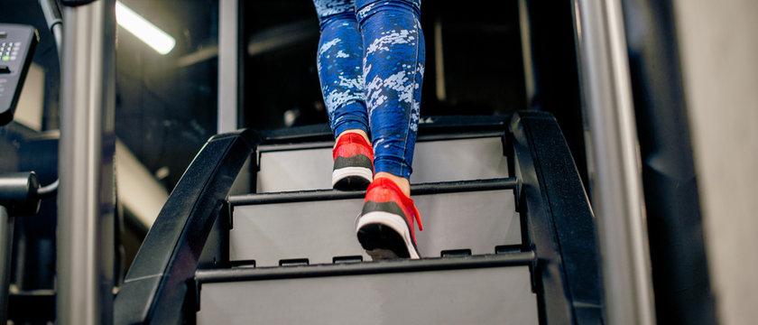 Panorama of girl on stairway machine