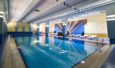 Swimming pool in modern gym fitness club