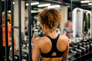 Girl in gym, taking pictures