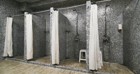 Empty Showers in modern Gym Locker Room