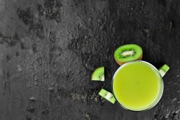 Kiwi Smoothies on a slate slab (selective focus)