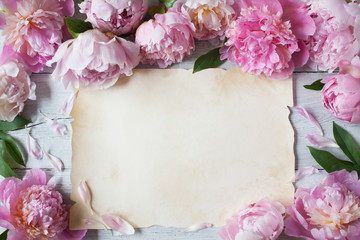 Background with peonies and paper for text congratulations