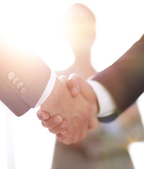 background image of handshake of business people .