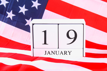 Wooden calendar with the date of January 19 on the American flag. Birthday Robert Edward Lee.