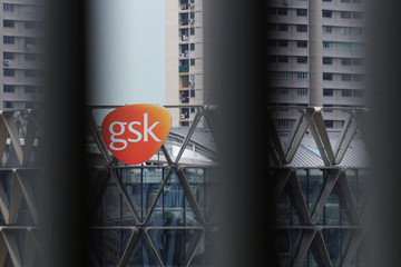 The GSK logo on the facade of GSK Asia House is seen through vertical louvres in Singapore
