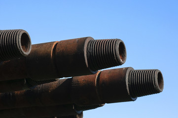 drill pipe threads against the blue sky background