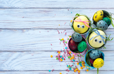 Easter background with yellow funny eggs. Happy easter greeting card with copy space. Flat lay, top view.