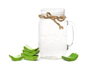 Healthy Aloe vera juice in a mason jar glass isolated on a white background