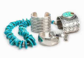 Collection of Sterling Silver Native American Bracelets with a Turquoise Nugget  Necklace with shallow depth of field.