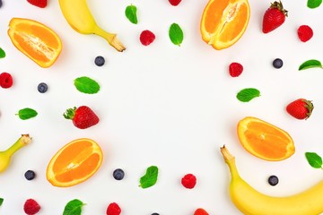 Colorful, bright fruit pattern with oranges, mint, berries and bananas over a white background....