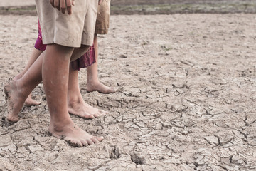 Drought caused by water shortage close up foot.