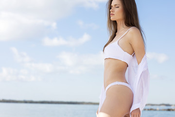 Beautiful healthy girl enjoy sunny day at the beach.