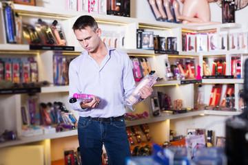 Man choosing erotic toys