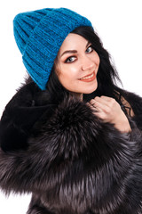 Smiling young woman in a warm hat