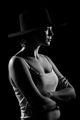 Young woman in a black hat