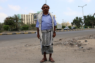 Ahmad Nasser al-Awlaqi poses for a photo in Aden