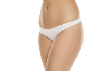 female waist, hips and white panties on white background