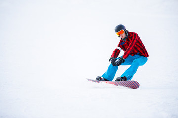 Image of athlete with snowboard riding in snowy resort