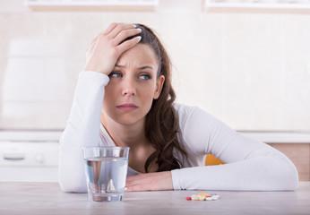 Woman feeling sad because of pills