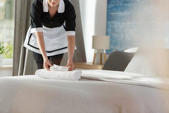 Maid laying fresh towels