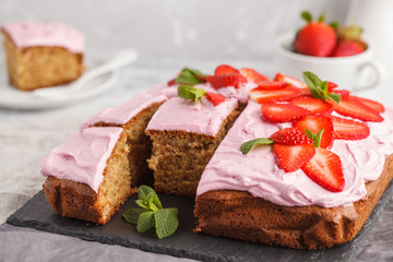 Yogurt pound cake for breakfast with pink glaze and fresh strawberries. Light background, summer dessert. Breakfast concept.