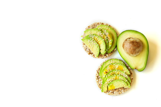 Isolate, toast, bread with avocado and sesame seeds, quail eggs on a white background