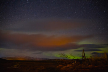 spectacular  view of night sky with northern lights and stars in iceland