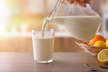 Glass of milk for breakfast finished drinking in rustic kitchen