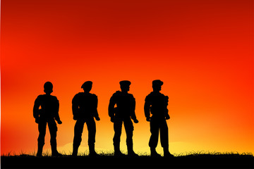 Silhouette of soldiers and Grassland when Sunrise / Sunset