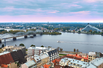 Sunset view from St. Peter's Church on the waterfront and the national library of Latvia, Riga