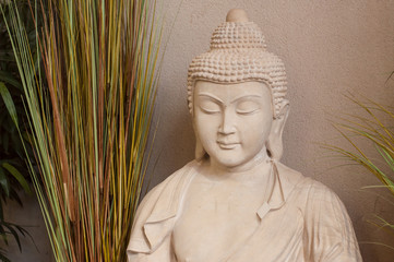 closeup of stoned buddha in gardening store for serenity decoration