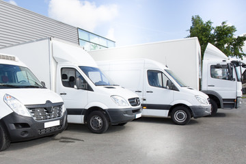 commercial delivery vans park in transport parking place of transporting carrier shipping service company Wall mural