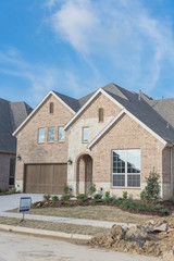 Brand new two story residential house, newly constructed almost completed. Pile of soils on pedestrian pathway.  Real estate development in suburban neighborhood at Irving, Texas, USA, landscaped yard