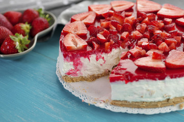 Sweet delicious strawberry cake on wooden background
