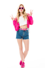 Young girl wearing pink hoodie showing victory sign isolated on white