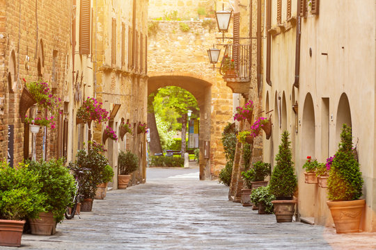 Colorful old street in Pienza, Tuscany, Italy
