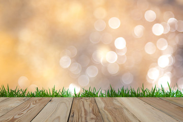 Background image blur Beautiful bokeh with wooden space and grass.