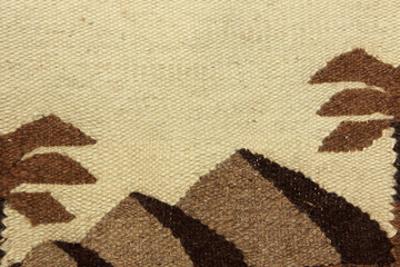 Camel wool fabric pattern with Egyptian pyramids silhouette.Abstract background.