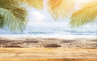 Hello summer table on Tropical Sand beach with sea and coconut palm leaves in relaxation time. Happiness and relax on the beach during summer concept.
