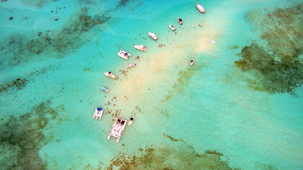 aerial of boats and people enjoying snorkeling in the crystal clear water Wall mural