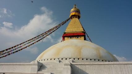 Front of Boudhanath Stupa in Kathmandu Nepal with blue sky background