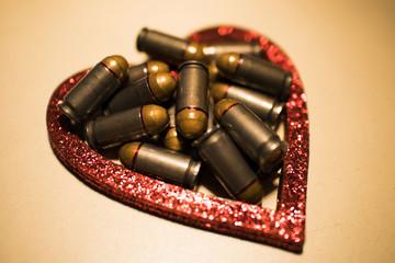 Red bullet shotgun cartridges in tin heart shape tin box. Gift for real man.