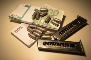 ammo and money on the table, the concept of chaos and banditry