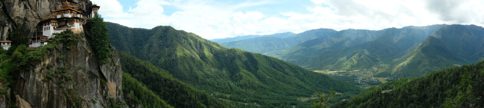 Panoramic view of Tiger's Nest Monastery, Paro Taktsang (top left) and surrounding breathtaking mountains in Bhutan