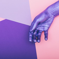 pearly purple hand. ultra violet concept. pastel minimal.